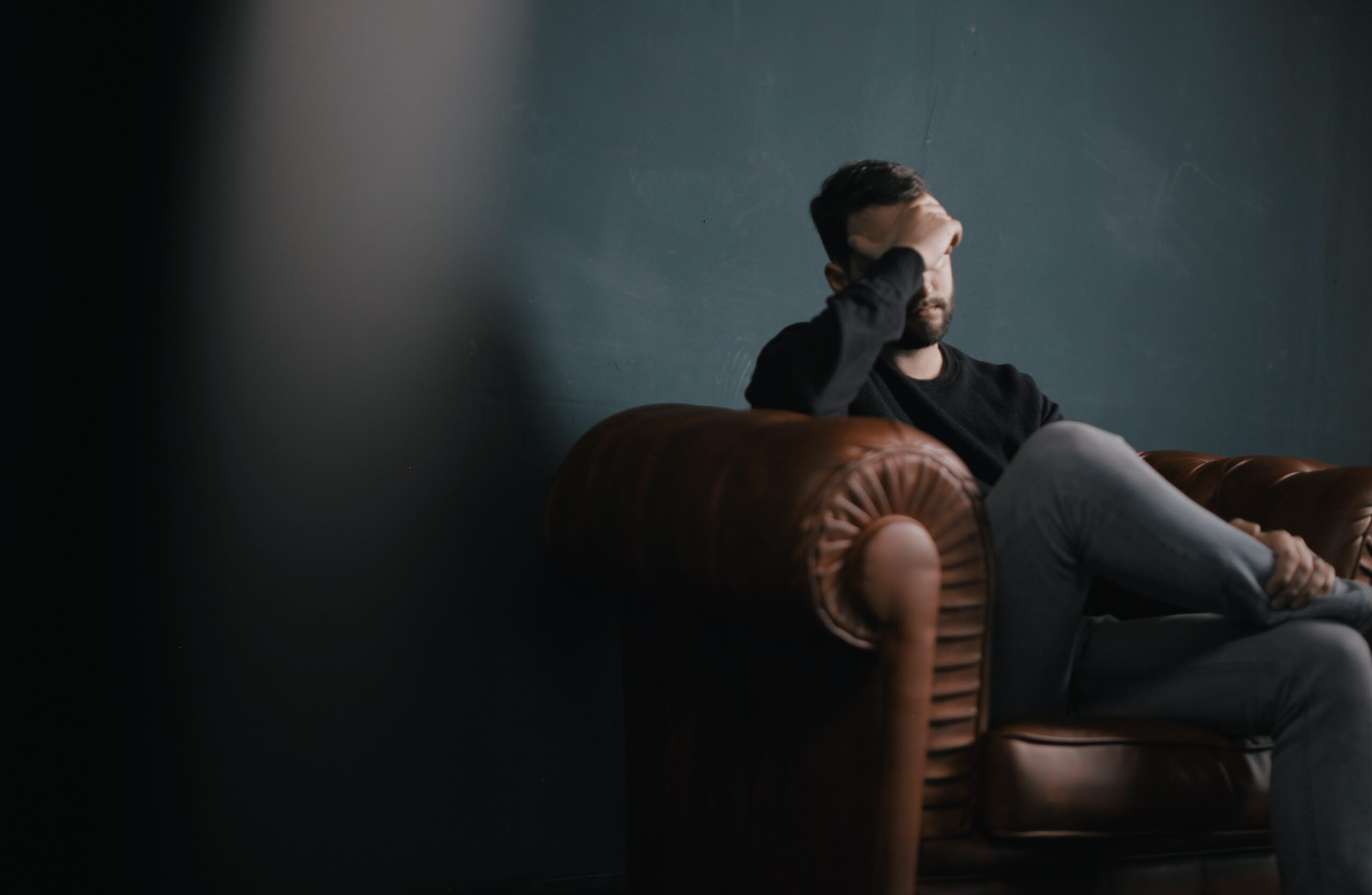 worried man on a couch